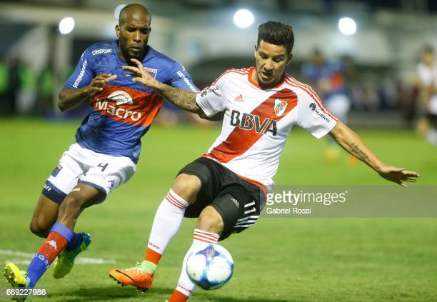 Sebastian Driussi of River Plate fights for the ball with Paulo Lima Simoes of Tigre during a match between Tigre and River Plate as part of Torneo...