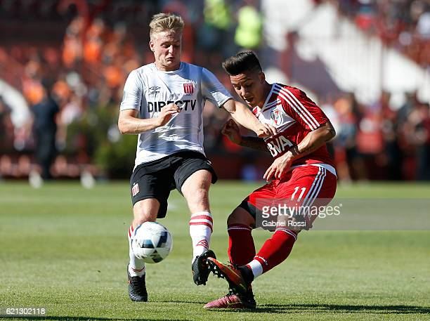 Sebastian Driussi of River Plate fights for the ball with Santiago Ascacibar of Estudiantes during a match between River Plate and Estudiantes as...