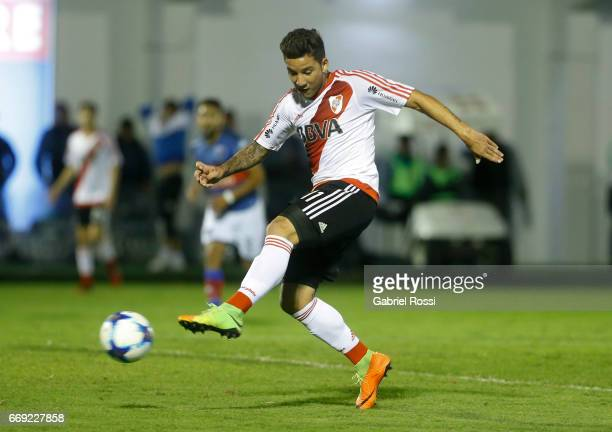 Sebastian Driussi of River Plate kicks the ball to score the first goal of his team during a match between Tigre and River Plate as part of Torneo...
