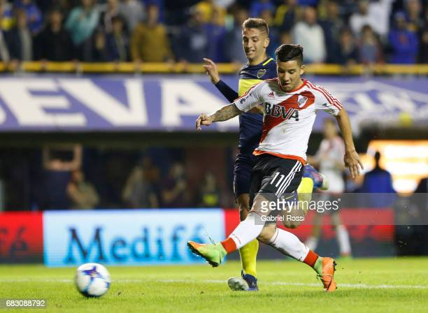 Sebastian Driussi of River Plate kicks the ball to score the third goal of his team during a match between Boca Juniors and River Plate as part of...