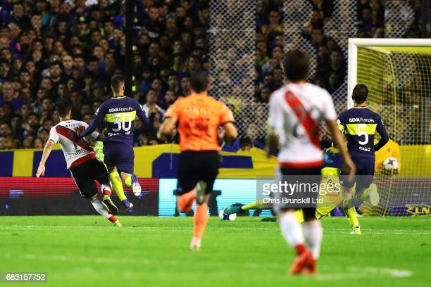 Sebastian Driussi of River Plate scores his side's third goal during the Torneo Primera Division match between Boca Juniors and River Plate at...