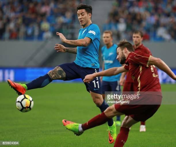 Sebastian Driussi of Zenit in action against Vladimir Granat of Rubin Kazan during the Russian Football Premier League match between Zenit St...