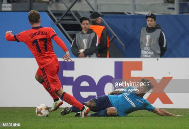 Sebastian Driussi of Zenit St Petersburg is in action against David Zurutuza of Real Sociedad during the UEFA Europa League Group L football match...
