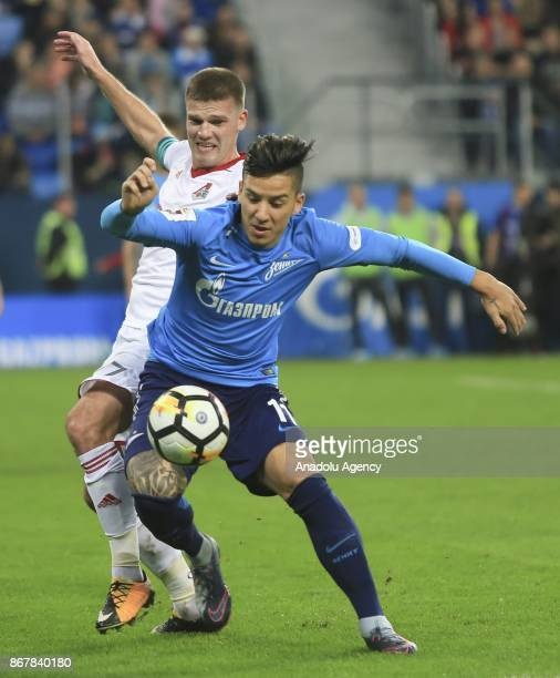 Sebastian Driussi of Zenit St Petersburg is in action against Igor Denisov of Lokomotiv Moscow during the Russian Football PremiereLeague match...