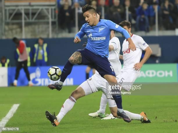 Sebastian Driussi of Zenit St Petersburg is in action against Solomon Kverkvelia of Lokomotiv Moscow during the Russian Football PremiereLeague match...