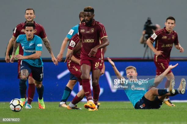 Sebastian Driussi Oleg Shatov of FC Zenit Saint Petersburg and Alex Song of FC Rubin Kazan vie for the ball during the Russian Football League match...