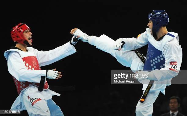 Sebastian Eduardo Crismanich of Argentina competes against Nicolas Garcia Hemme of Spain in the Men's 80kg Taekwondo Gold Medal Final on Day 14 of...