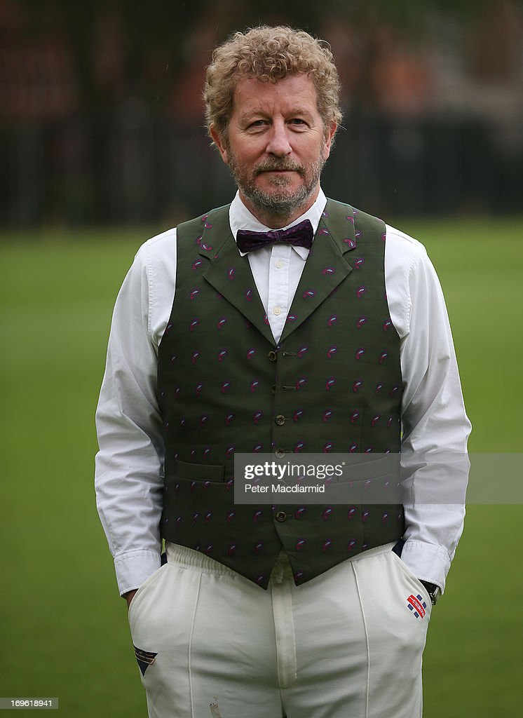 <a gi-track='captionPersonalityLinkClicked' href=/galleries/search?phrase=Sebastian+Faulks&family=editorial&specificpeople=4473584 ng-click='$event.stopPropagation()'>Sebastian Faulks</a> wears Victorian costume as he prepares to take part in a cricket match in Vincent Square on May 29, 2013 in London, England. The match celebrates the 150th anniversary the Wisden Cricketers' Almanack. The almanack is a cricket reference book published one a year in the United Kingdom.