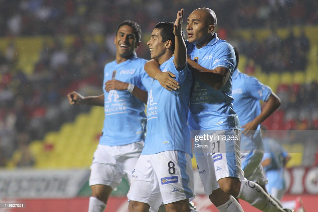 Sebastian Fernandez of San Luis celebrates a goal with his teammates during a match between Morelia and San Luis as part of the Torneo Apertura 2012...