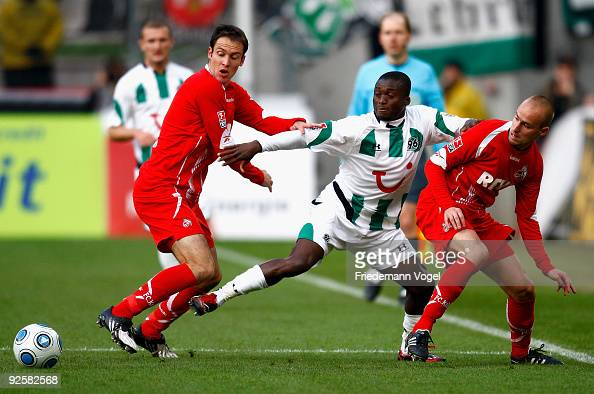 Sebastian Freis and Miso Brecko of Koeln in action with Constant Djakpa of Hannover during the Bundesliga match between 1 FC Koeln and Hannover 96 at...