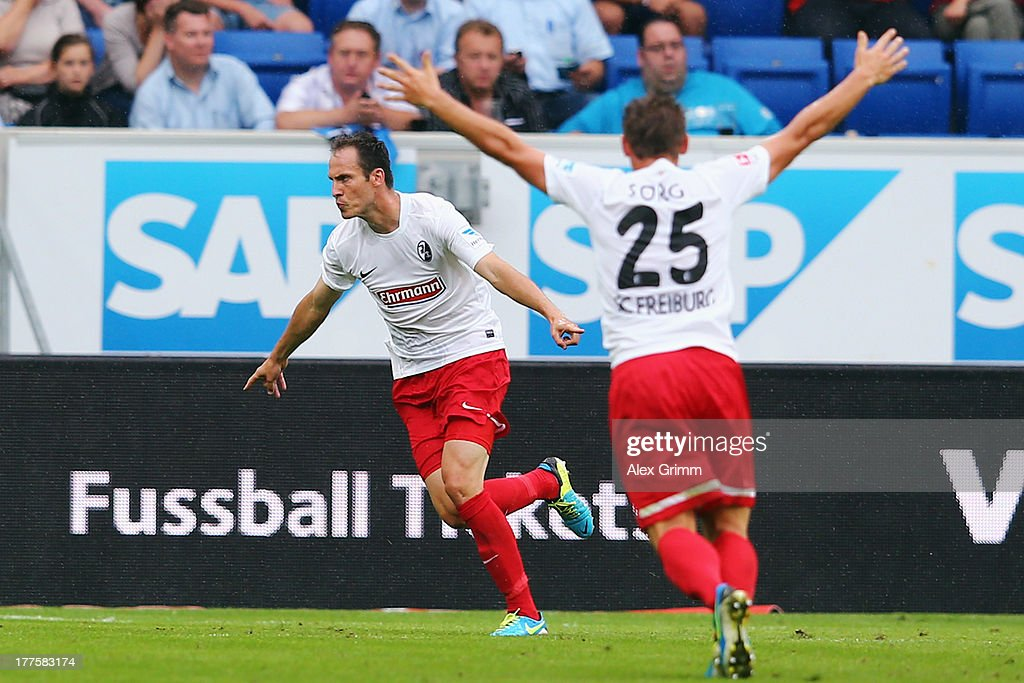 <a gi-track='captionPersonalityLinkClicked' href=/galleries/search?phrase=Sebastian+Freis&family=editorial&specificpeople=741981 ng-click='$event.stopPropagation()'>Sebastian Freis</a> (L) of Freiburg celebrates his team's third goal with team mate Oliver Sorg during the Bundesliga match between 1899 Hoffenheim and SC Freiburg at Wirsol Rhein-Neckar-Arena on August 24, 2013 in Sinsheim, Germany.