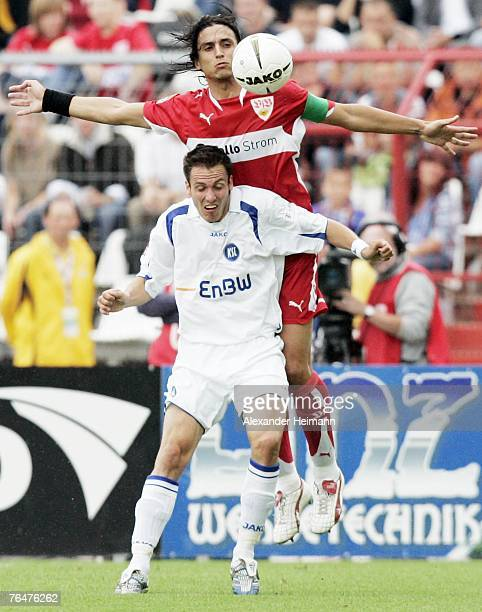 Sebastian Freis of Karlsruhe competes with Fernando Meira of Stuttgart during the Bundesliga match between Karlsruher SC and VFB Stuttgart at the...