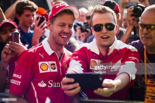 Sebastian from Germany of scuderia Ferrari taking a selfie with a fan during the Formula One Belgian Grand Prix at Circuit de SpaFrancorchamps on...