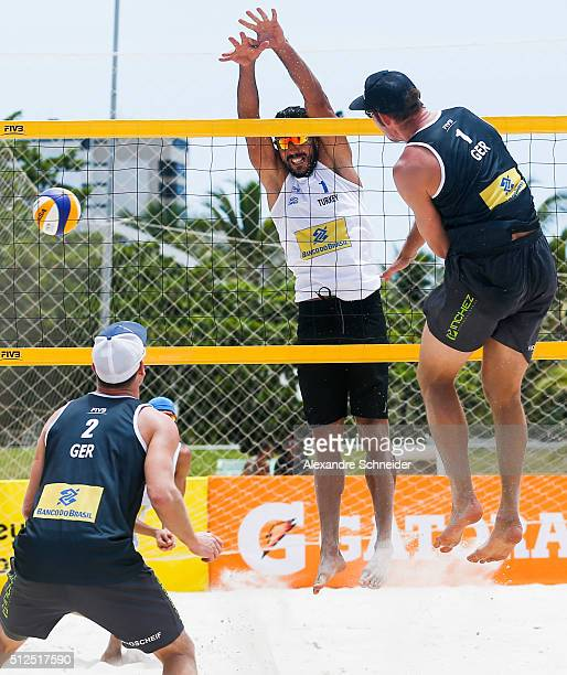 Sebastian Fuchs of Germany spikes the ball during the main draw match against Turkey at Pajucara beach during day four of the FIVB Beach Volleyball...