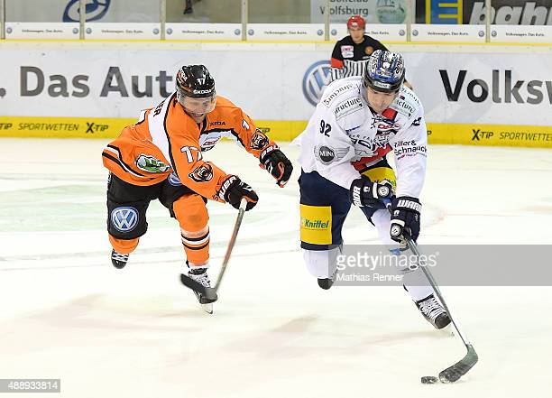 Sebastian Furchner of Grizzly Wolfsburg and Marcel Noebels of the Eisbaeren Berlin during the game between Grizzlys Wolfsburg against Eisbaeren...