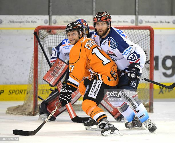 Sebastian Furchner of the Grizzly Adams Wolfsburg and Sean Sullivan of the Iserlohn Roosters during the game between Grizzly Adams Wolfsburg and...