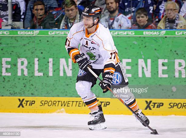 Sebastian Furchner of the Grizzly Adams Wolfsburg handles the puck during the game between Eisbaeren Berlin and EHC Wolfsburg at O2 World on December...