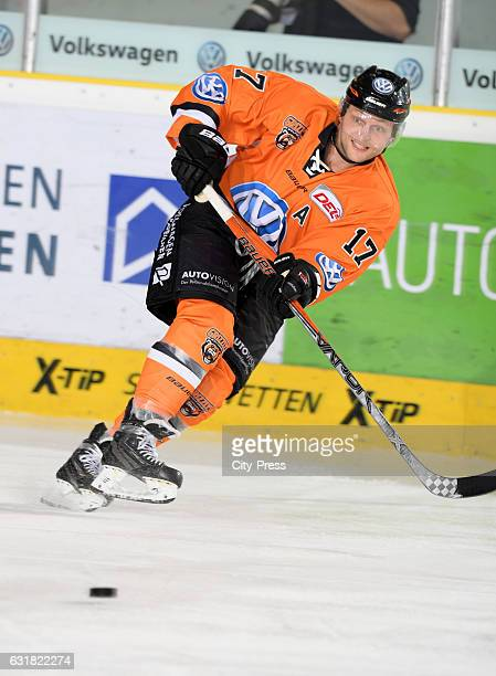Sebastian Furchner of the Grizzlys Wolfsburg passes the puck during the action shot on September 25 2016 in Wolfsburg Germany