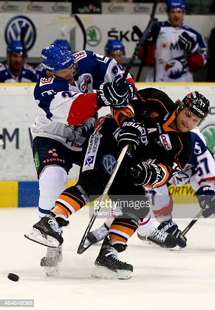 Sebastian Furchner of Wolfsburg and Denis Reul of Mannheim battle for the puck during the DEL match between Grizzly Adams Wolfsburg and Adler...