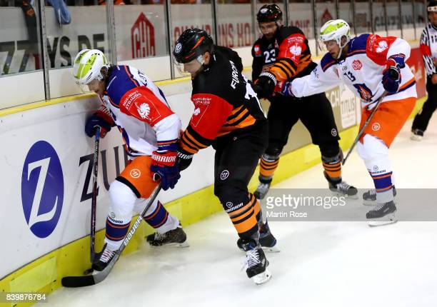 Sebastian Furchner of Wolfsburg and Mikko Lehtonen of Tampere battle for the puck during the Champions Hockey League match between Grizzlys Wolfsburg...