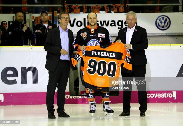 Sebastian Furchner of Wolfsburg is hoinored for 900 DEL matches before the DEL match between Grizzlys Wolfsburg and Adler Mannheim at Eisarena...