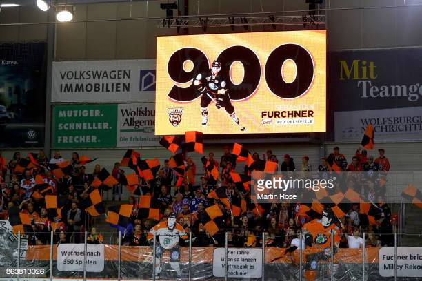 Sebastian Furchner of Wolfsburg is honored for 900 DEL matches before the DEL match between Grizzlys Wolfsburg and Adler Mannheim at Eisarena...