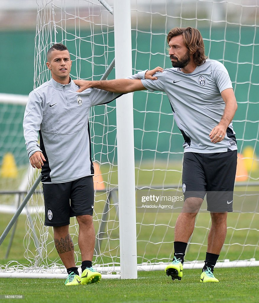 Sebastian Giovinco (L) and Andrea Pirlo (R) of Juventus during a training session on October 01, 2013 in Turin, Italy. Turkey's Galatasaray to face Italy's Juventus in the UEFA Champions League Group B match on October 2, 2013 at Juventus Stadium.