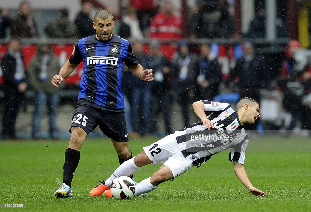 Sebastian Giovinco of Juventus FC #12 and Walter Samuel of FC Inter Milan compete for the ball during the Serie A match between FC Internazionale Milano and Juventus FC at San Siro Stadium on March 30, 2013 in Milan, Italy.