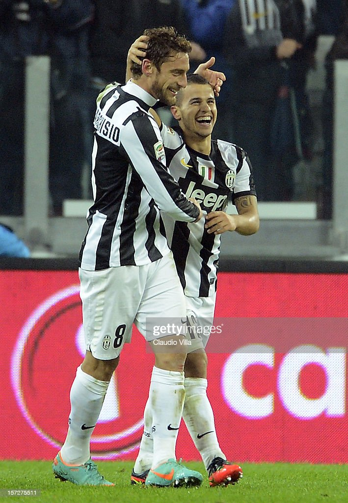 <a gi-track='captionPersonalityLinkClicked' href=/galleries/search?phrase=Sebastian+Giovinco&family=editorial&specificpeople=4284715 ng-click='$event.stopPropagation()'>Sebastian Giovinco</a> of Juventus FC (R) celebrates scoring the second goal during the Serie A match between Juventus and Torino FC at Juventus Arena on December 1, 2012 in Turin, Italy.