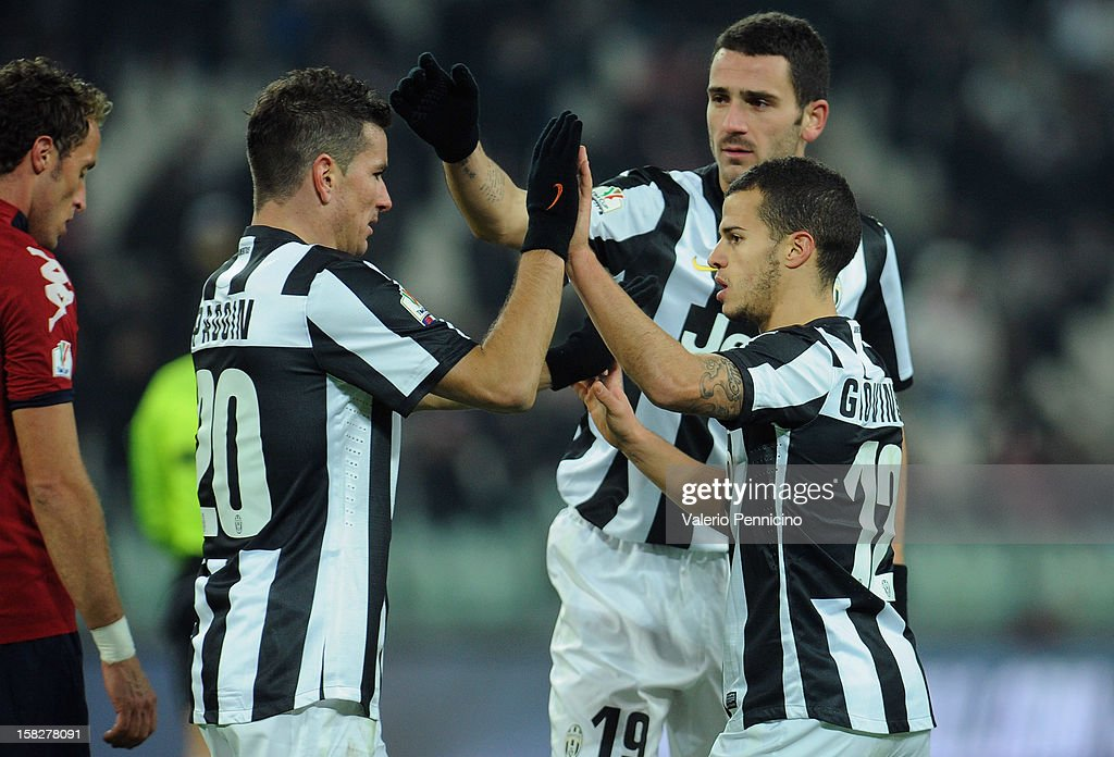 Sebastian Giovinco (R) of Juventus FC celebrates the opening goal with his team-mates during the TIM Cup match between Juventus FC and Cagliari Calcio at Juventus Arena on December 12, 2012 in Turin, Italy.