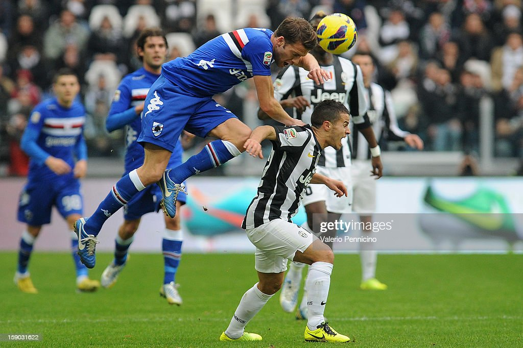 Sebastian Giovinco (R) of Juventus FC ischallenged by Andrea Costa of UC Sampdoria during the Serie A match between Juventus FC and UC Sampdoria at Juventus Arena on January 6, 2013 in Turin, Italy.
