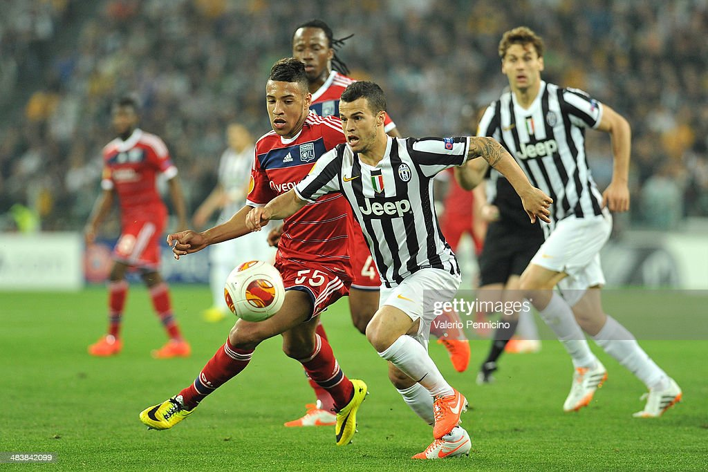 Sebastian Giovinco (R) of Juventus is challenged by Corentin Tolisso of Olympique Lyonnais during the UEFA Europa League quarter final match between Juventus and Olympique Lyonnais at Juventus Arena on April 10, 2014 in Turin, Italy.