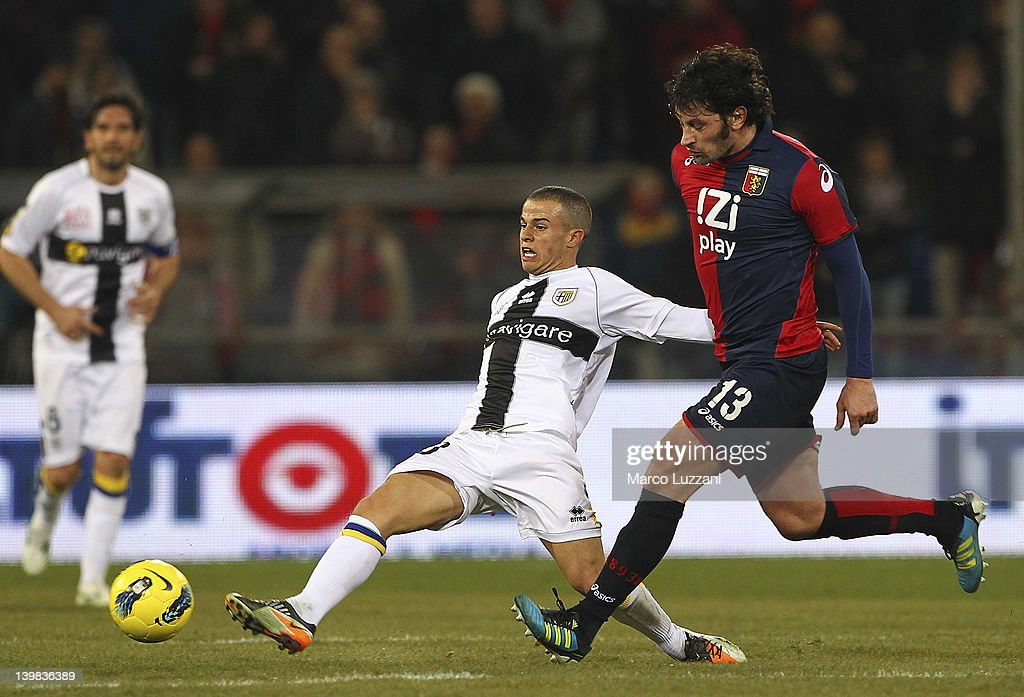 <a gi-track='captionPersonalityLinkClicked' href=/galleries/search?phrase=Sebastian+Giovinco&family=editorial&specificpeople=4284715 ng-click='$event.stopPropagation()'>Sebastian Giovinco</a> of Parma FC competes for the ball with <a gi-track='captionPersonalityLinkClicked' href=/galleries/search?phrase=Kakha+Kaladze&family=editorial&specificpeople=646904 ng-click='$event.stopPropagation()'>Kakha Kaladze</a> of Genoa CFC during the Serie A match between Genoa CFC and Parma FC at Stadio Luigi Ferraris on February 25, 2012 in Genoa, Italy.