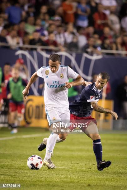 Sebastian Giovinco of the MLS AllStar team battles for control against Lucas Vazquez of Real Madrid during the MLS AllStar match between the MLS...