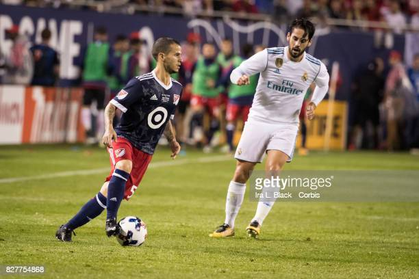 Sebastian Giovinco of the MLS AllStar team drives around Isco of Real Madrid during the MLS AllStar match between the MLS AllStars and Real Madrid at...