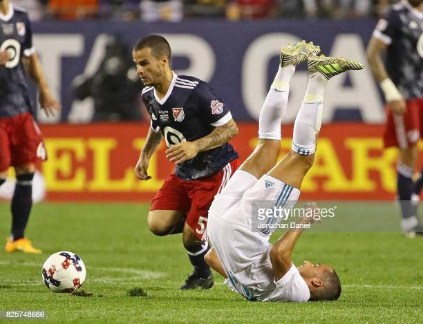 Sebastian Giovinco of the MLS AllStars moves around Lucas Vazquez of Real Mardrid during the 2017 MLS All Star Game at Soldier Field on August 2 2017...