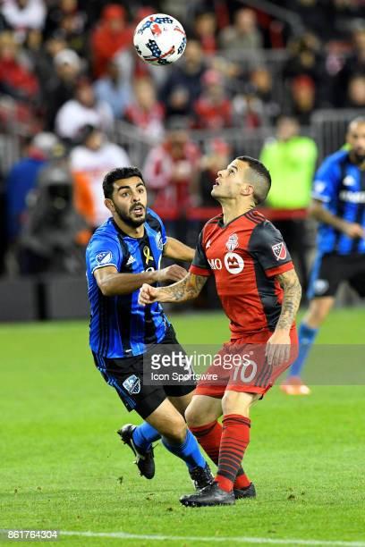 Sebastian Giovinco of Toronto FC and Hernán Bernardello of Montreal Impact battle for the ball during the second half of the MLS Soccer regular...
