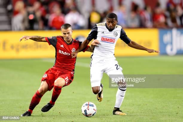 Sebastian Giovinco of Toronto FC battles for the ball against Ray Gaddis of Philadelphia Union during the first half of the MLS Soccer regular season...