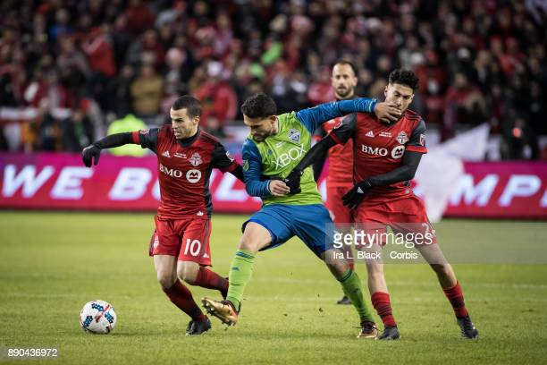 Sebastian Giovinco of Toronto FC breaks away from Cristian Roldan of Seattle Sounders during the 2017 Audi MLS Championship Cup match between Toronto...
