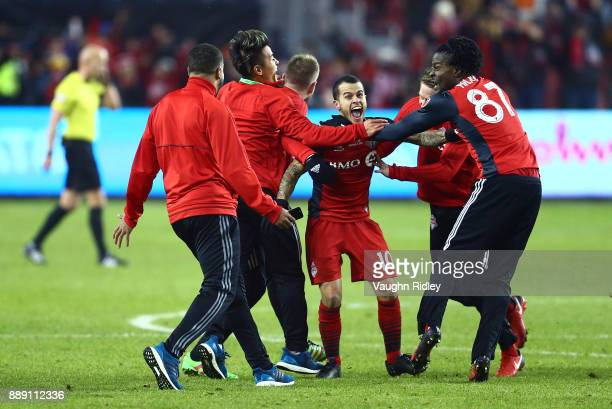 Sebastian Giovinco of Toronto FC celebrates victory over the Seattle Sounders following the final whistle of the 2017 MLS Cup Final at BMO Field on...