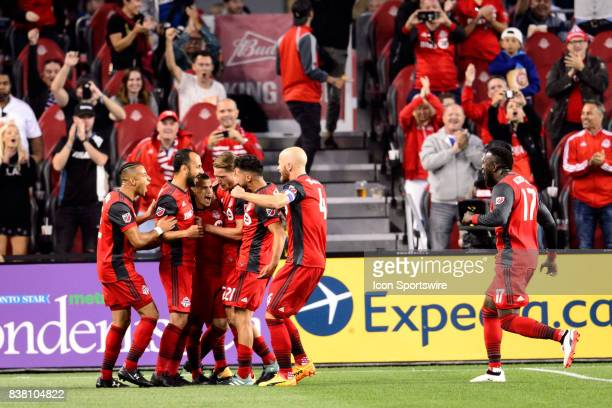 Sebastian Giovinco of Toronto FC celebrates with his Toronto FC team mates after scoring during the first half of the MLS Soccer regular season game...