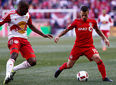 Sebastian Giovinco of Toronto FC dribbles by Ronald Zubar of New York Red Bulls during their match at Red Bull Arena on March 6 2016 in Harrison New...