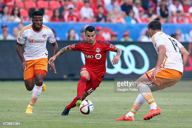 Sebastian Giovinco of Toronto FC dribbles past David Horst of the Houston Dynamo during an MLS soccer game between the Houston Dynamo and Toronto FC...