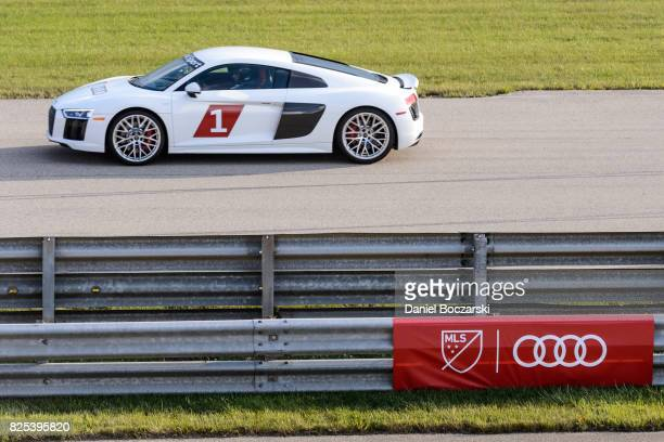 Sebastian Giovinco of Toronto FC drives on the track as Audi hits the track with Major League Soccer AllStar players ahead of MLS AllStar Game in...
