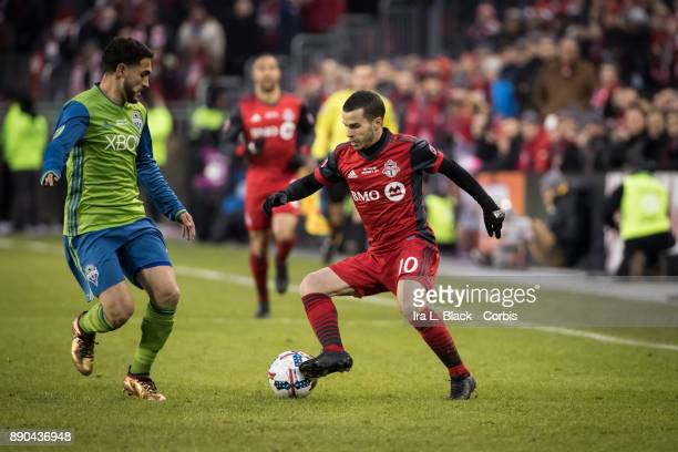 Sebastian Giovinco of Toronto FC drives the ball against Cristian Roldan of Seattle Sounders during the 2017 Audi MLS Championship Cup match between...