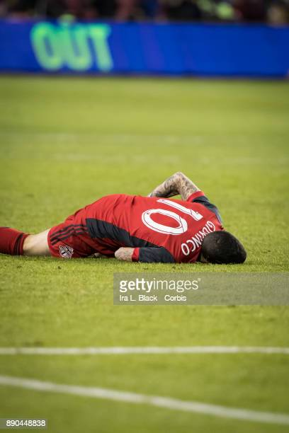Sebastian Giovinco of Toronto FC goes down after a hit during the 2017 Audi MLS Championship Cup match between Toronto FC and Seattle Sounders FC at...