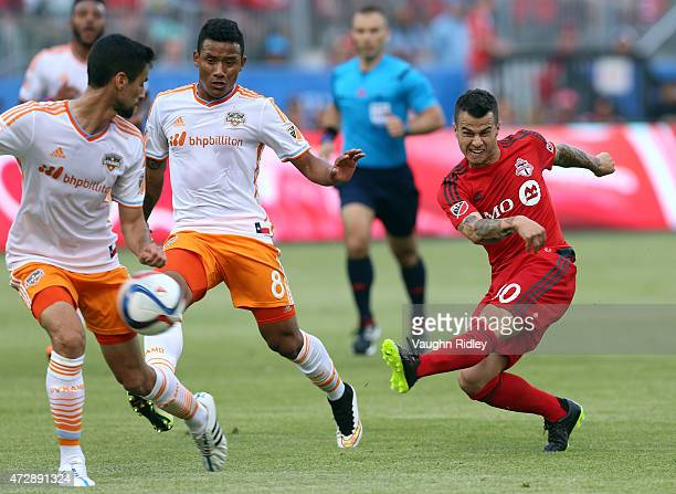Sebastian Giovinco of Toronto FC has a shot on goal during an MLS soccer game between the Houston Dynamo and Toronto FC at BMO Field on May 10 2015...