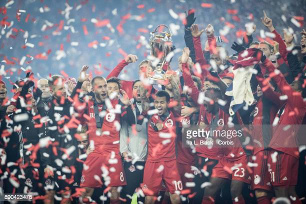 Sebastian Giovinco of Toronto FC hoists the MLS Champions Cup above his head with the rest of the team after the 2017 Audi MLS Championship Cup match...