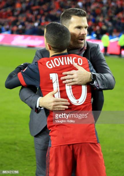 Sebastian Giovinco of Toronto FC hugs Head Coach Greg Vanney following the final whistle of the MLS Eastern Conference Finals Leg 2 game against...