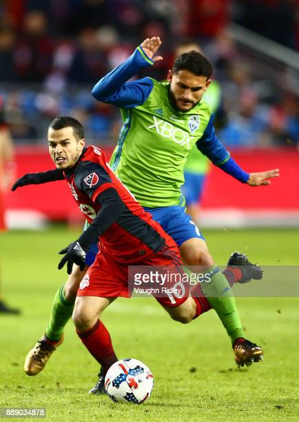 Sebastian Giovinco of Toronto FC is fouled by Christian Roldan of the Seattle Sounders during the first half of the 2017 MLS Cup Final at BMO Field...